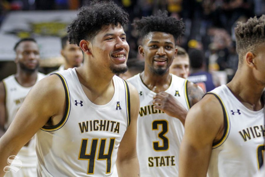 Wichita State sophomore Isaiah Poor Bear-Chandler smiles as he walks off the court after defeating UT-Martin on Nov. 16 inside Charles Koch Arena.