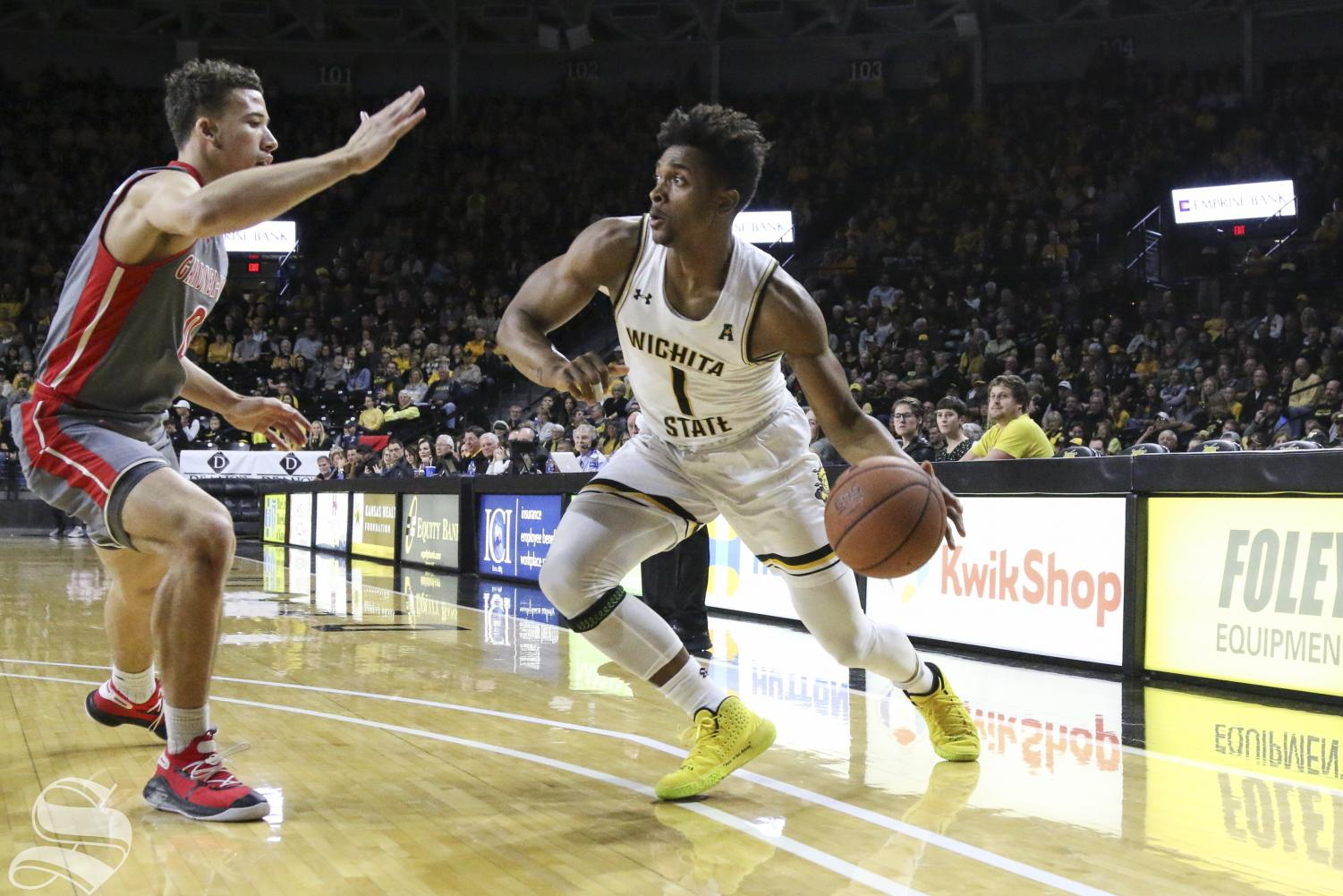 Wichita State freshman Tyson Etienne looks to drive the ball past Gardner-Webb's defense on Tuesday, Nov. 19, 2019, at Charles Koch Arena.