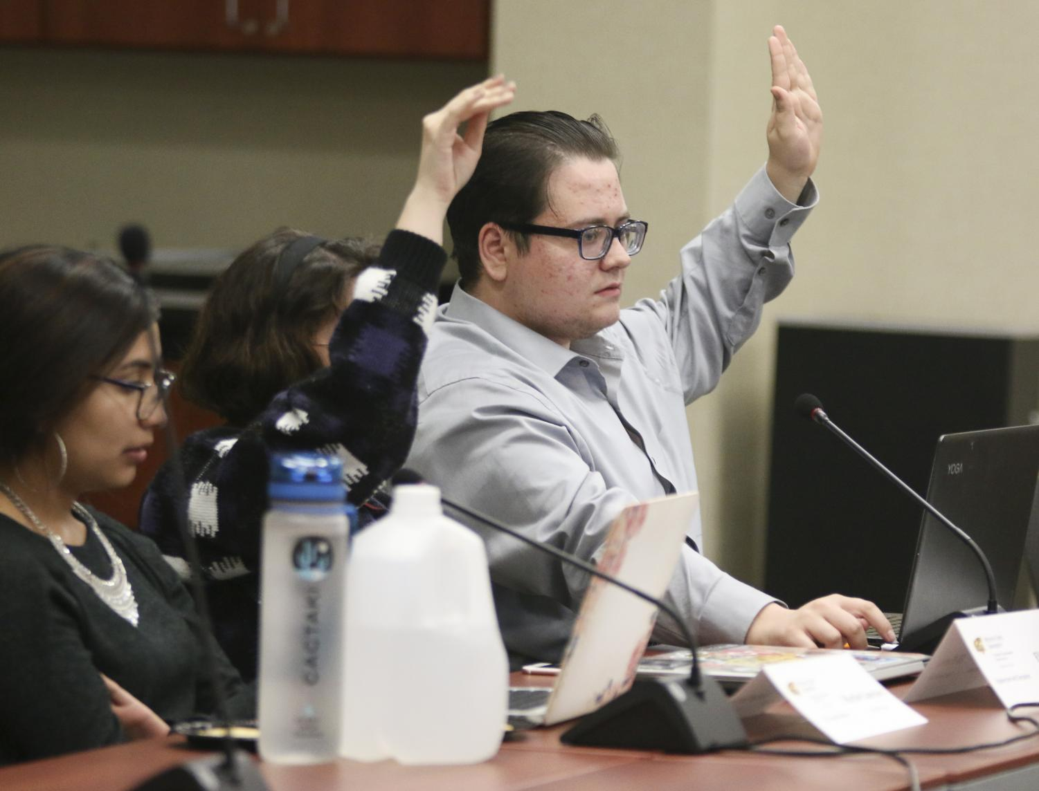 At-Large Sen. Grant Day raises his hand to ask a question during Student Government Association's Nov. 20 meeting, where senators discussed a bill to make changes to the annual student fees process. Day also represents the College of Liberal Arts and Sciences on this year's Student Fees Committee.
