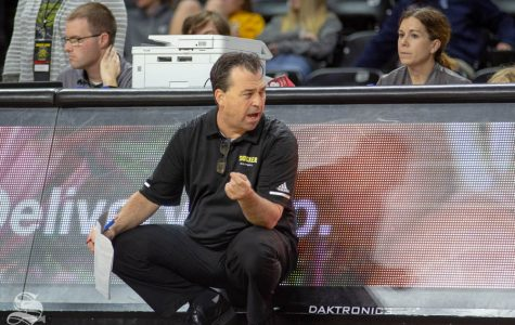 Wichita State Head Coach Chris Lamb reacts to a call during the first set of the match against Tulsa on Nov. 15 inside Charles Koch Arena.