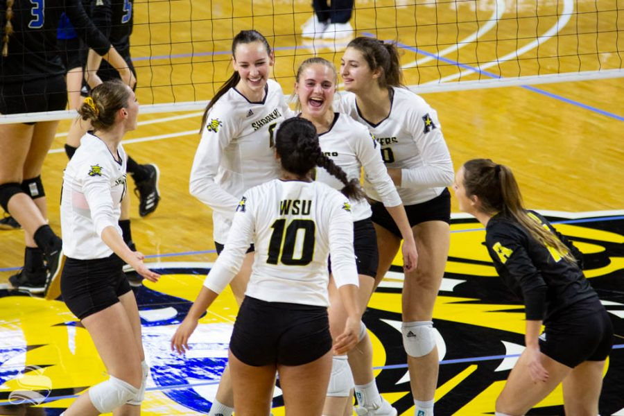 Wichita+State+freshman+Kayce+Litzau+celebrates+with+her+teammates+after+winning+a+point+during+the+match+against+Tulsa+on+Nov.+15+inside+Charles+Koch+Arena.