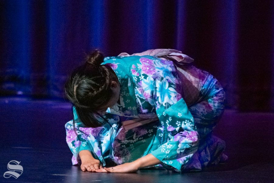 Freshman Marina Hata finishes her performance of a traditional fan dance during Yokoso: Japanese Culture Night on Friday, Nov. 1 at the CAC Theater.