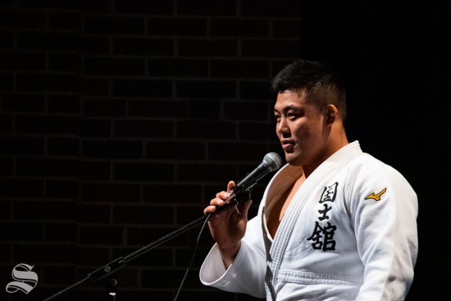Sophomore Akishige Kuraishi speaks to the crowd about the Wichita State Judo Clubs demonstration during Japanese Culture Night on Friday, Nov. 1 at the CAC Theater.