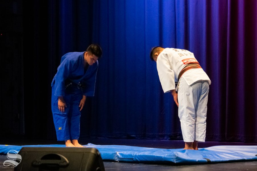 Junior Stefano Bardelli and sophomore Akishige Kuraishi bow in preparation for their judo demonstration during Japanese Culture Night on Friday, Nov. 1 in the CAC Theater.