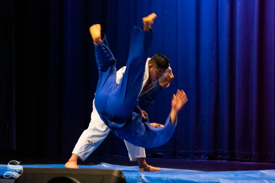 Sophomore Akishige Kuraishi drops junior Stefano Bardelli to their crash mat during Wichita States Judo Club demonstration during Japanese Culture Night on Friday, Nov. 1 at the CAC Theater.