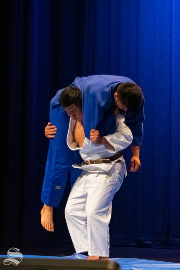 Sophomore Akishige Kuraishi lifts junior Stefano Bardelli during Wichita States Judo Club demonstration during Japanese Culture Night on Friday, Nov. 1 at the CAC Theater.
