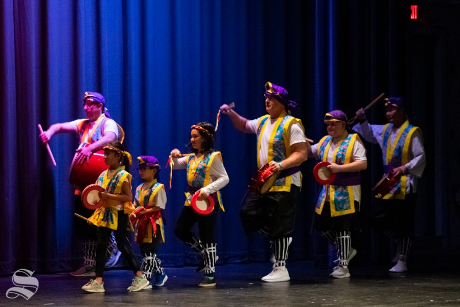 Okinawa Karate Dojo members perform an Eisa Drum Dance during Japanese Culture Night on Friday, Nov. 1 at the CAC Theater.