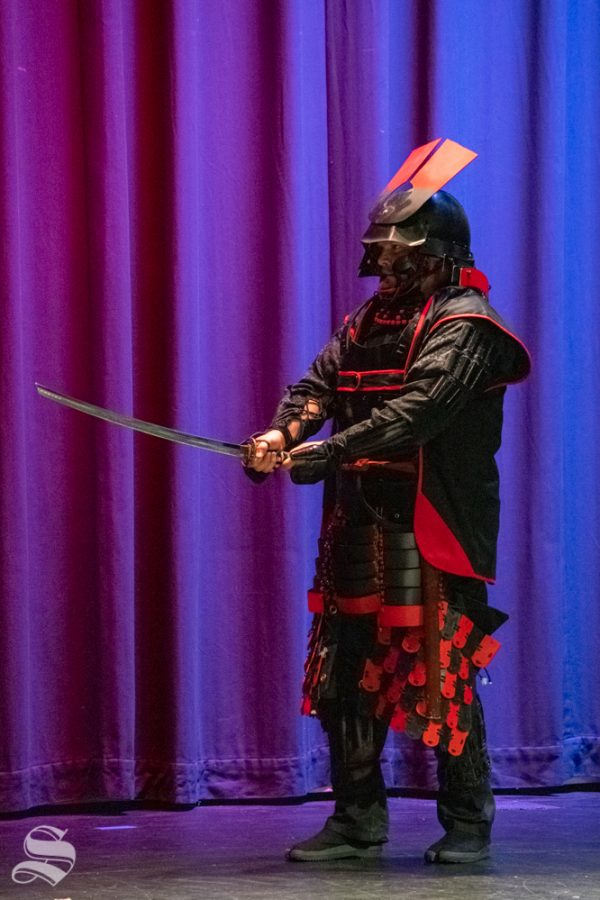 Tora Lawson, sensei of the Tosa No Shugyo Dojo, performs an armored sword demonstration during Japanese Culture Night on Friday, Nov. 1 at the CAC Theater. Lawson founded the Tosa No Shugyo school in Wichita after 34 years of study in Japanese martial arts.