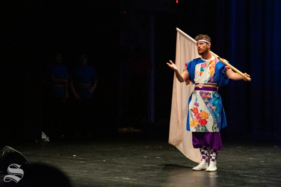 Ryan M. Kenny, a senior studying mechanical engineering at Kansas State, speaks to the crowd about the final dance that the Kansas State University Yosakoi Dancers will perform during Japanese Culture Night on Friday, Nov. 1 at the CAC Theater.