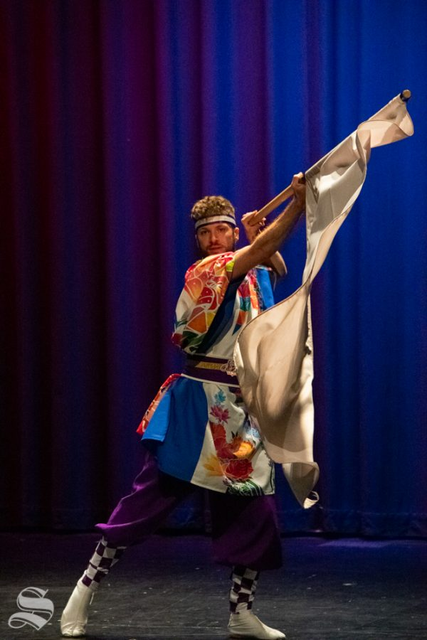 Ryan M. Kenny, a senior studying mechanical engineering at Kansas State, performs with the Kansas State University Yosakoi Dancers during Japanese Culture Night on Friday, Nov. 1 at the CAC Theater.