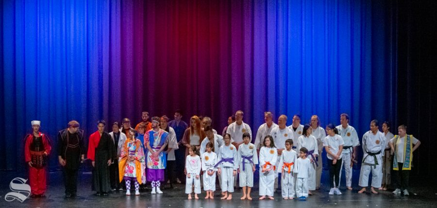 Yokoso: Japanese Culture Night performers line up for photos at the end of their event on Friday, Nov. 1 at the CAC Theater.