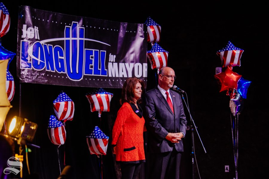 Susie and Jeff Longwell take the stage at WAVE in downtown Wichita on Tuesday, Nov. 5 during the Longwell mayoral watch party. Longwell lost the race and Brandon Whipple will be the next Mayor of Wichita.