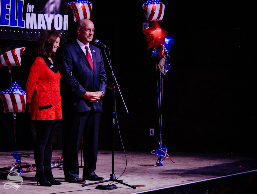 Susie Longwell stands with her husband Jeff while he addresses the crowd during his mayoral watch party on Tuesday, Nov. 5 at WAVE in downtown Wichita.
