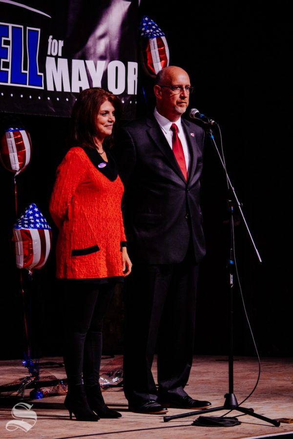 Susie Longwell stands with her husband Jeff while he thanks the crowd for his time as Mayor of Wichita during the Longwell watch party on Tuesday, Nov. 5 at WAVE in downtown Wichita.