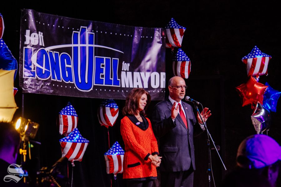Susie Longwell stands with her husband Jeff while he speaks to the crowd during the mayoral watch party on Tuesday, Nov. 5 at WAVE in downtown Wichita. Brandon Whipple won the election and will be the next Mayor of Wichita.
