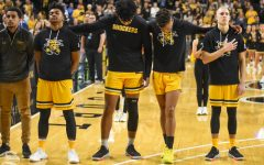 Wichita State's Tyson Etienne, Isaiah Poor Bear-Chandler, Dexter Dennis, and Brycen Bush stand together during the national anthem before the game agianst Omaha on Tuesday.