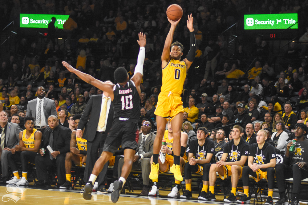 Wichita State sophomore Dexter Dennis shoots a three-pointer during the game against the Omaha Mavericks on Tuesday, Nov. 5 in Charles Koch Arena.