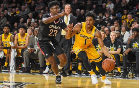 Freshman Tyson Etienne drives to the basket for a shot during the game against the Mavericks on Tuesday in Charles Koch Arena.