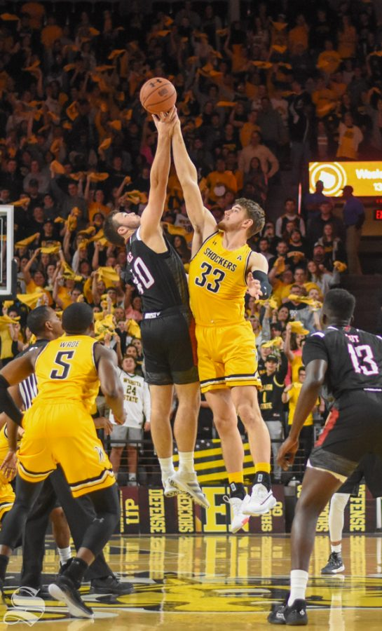 Wichita+State+junior+Asbj%C3%B8rn+Midtgaard+goes+up+for+the+ball+at+tip-off+during+the+game+against+Omaha+on+Tuesday%2C+Nov.+5.