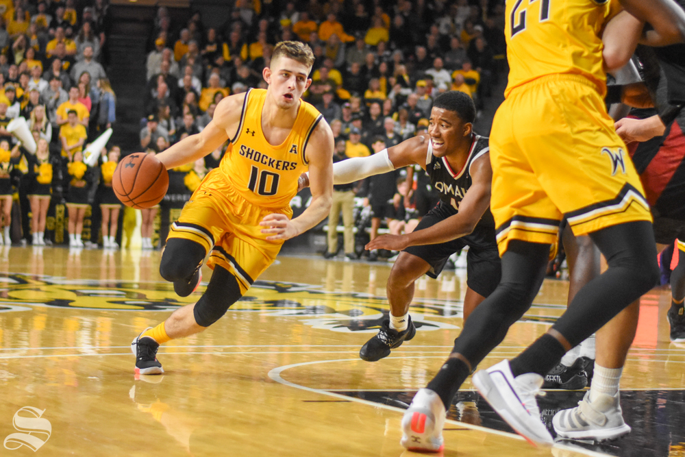 Wichita State sophomore Erik Stevenson drives to the basket to make a shot against the Omaha Mavericks on Tuesday, Nov. 5 in Charles Koch Arena.