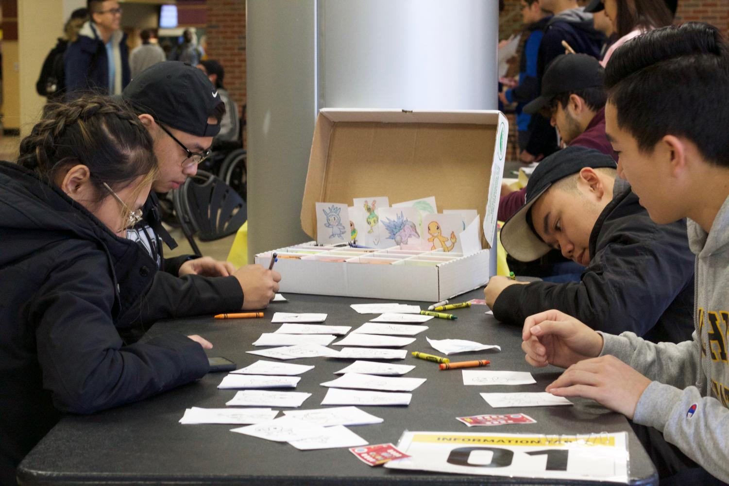 Students color pictures of various Pokemon as part of the Asian Student Conference's Pokemon festival on Wednesday in the RSC. Participants at the event made their way through different stations to collect all eight gym badges and become a Pokemon Master.