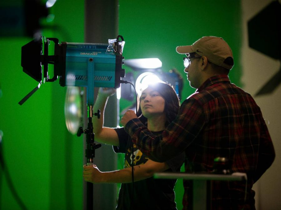 A student in WSU's media arts program works with film lighting at Shocker Studios. The university announced on Wednesday that the program would be encompassed by a brand new School of Digital Arts.