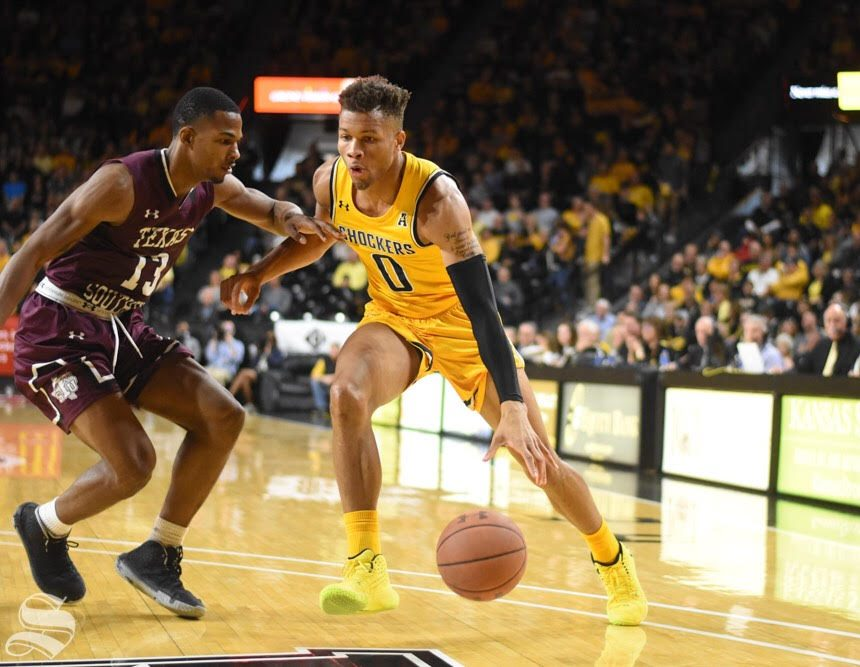 Wichita State sophomore Dexter Dennis drives past a Texas Southern defender during the first half of the game against the Tigers on Saturday inside Charles Koch Arena.