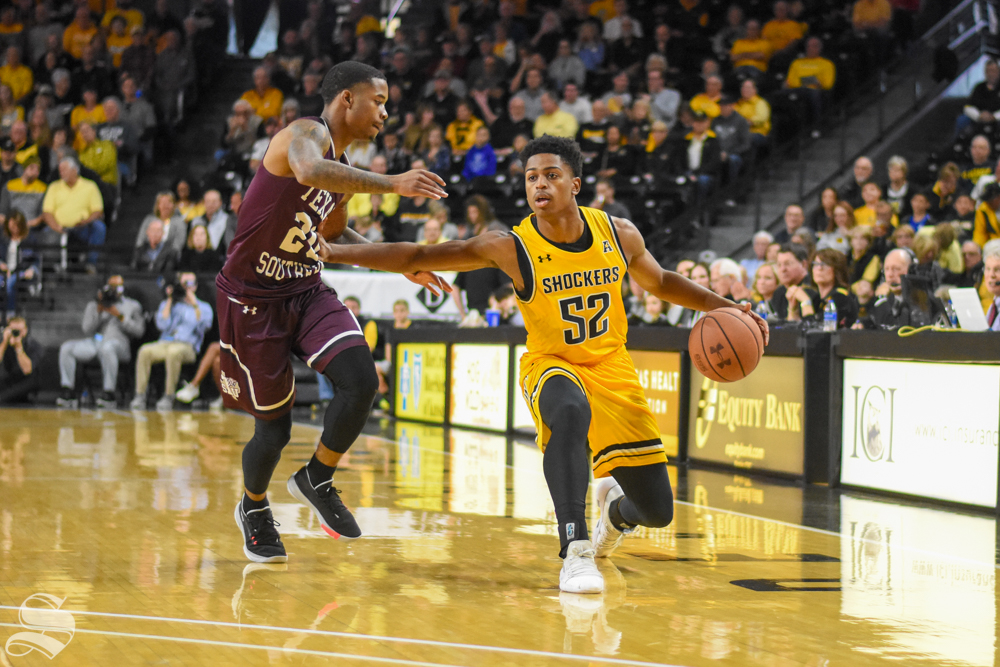 Wichita State freshman Grant Sherfield dribbles to the three-point line during the game against Texas Southern on Saturday in Charles Koch Arena.