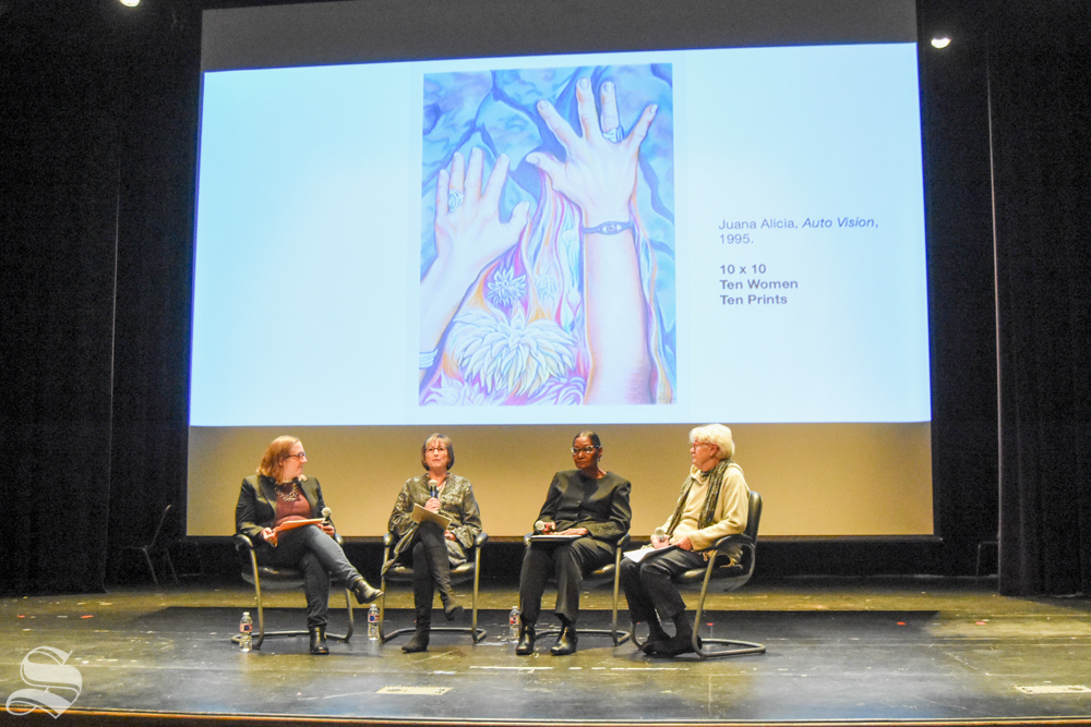 """WSU Women's Studies graduate Lee Starkel, WSU Women's Studies instructor Carolyn Williams, and Novelene Ross, former chief curator of the Wichita Art Museum speak at """"Voices from the Vault Panel: Feminism in the West in the 1970s"""" in the CAC Auditorium on Tuesday."""