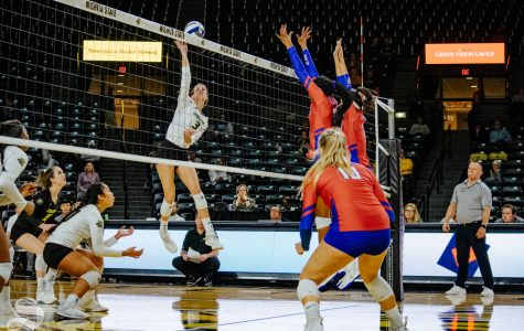Freshman Brylee Kelly jumps to attack the ball during Wichita State's match against Southern Methodist University on Friday, Nov. 8 in Charles Koch Arena.