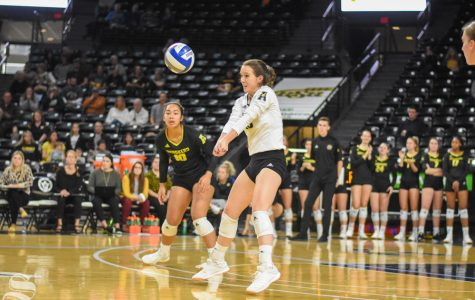 Wichita State senior Kara Brown returns a serve during the game against the University of Memphis on Sunday.