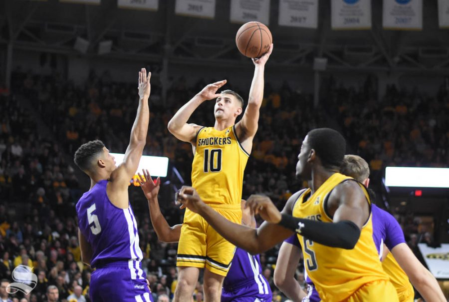 Wichita State sophomore Erik Stevenson goes up for a hook shot in the first half of the game against Abilene Christian on Sunday inside Charles Koch Arena.