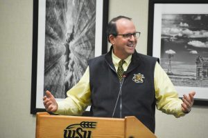 University President Jay Golden, then president-elect, speaks at a Student Government Association meeting in December, 2019.