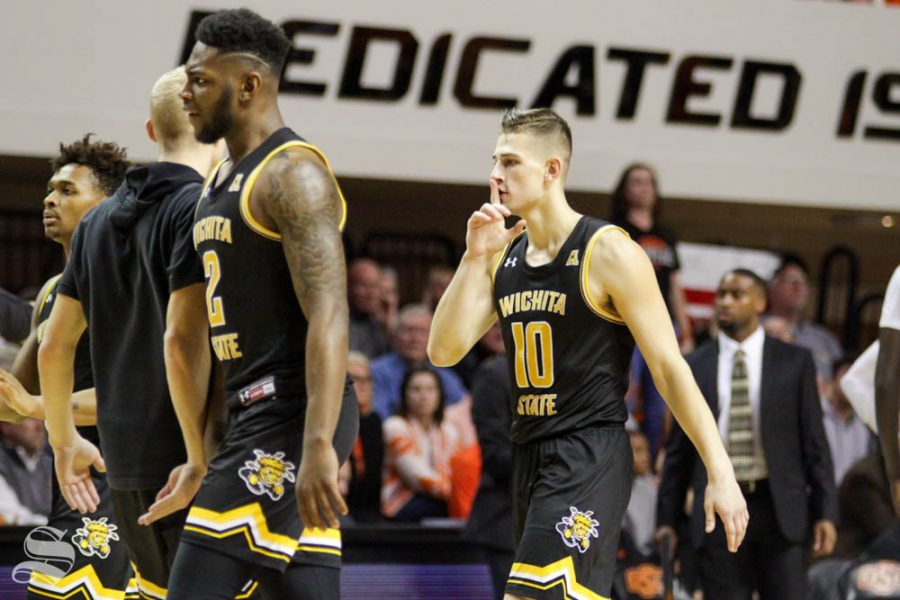 Wichita State sophomore Erik Stevenson shushes the Oklahoma State crowd after making a three-pointer during the second half of the game against the Cowboys on Sunday inside Gallagher-Iba Arena.