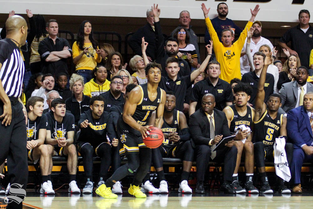 Wichita State freshman Tyson Etienne prepares to shoot a three during the second half of the game against Oklahoma State on Sunday inside Gallagher-Iba Arena.