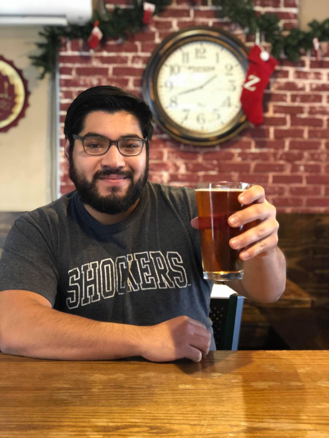 Opinion Editor Kevin Benavides has a celebratory drink at Ziggy's Pizza.