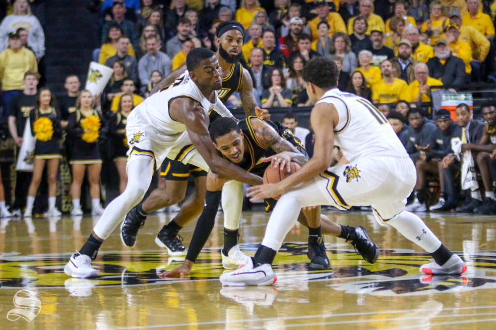 Wichita State's Trey Wade and Noah Fernandes cause a jump ball during the first half of the game against VCU on Saturday inside Charles Koch Arena.