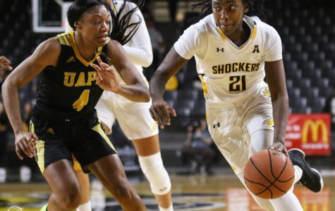 Wichita State's Maya Brewer drives the ball down the court during the game against Arkansas Pine-Bluff Monday, Dec. 16, 2019.