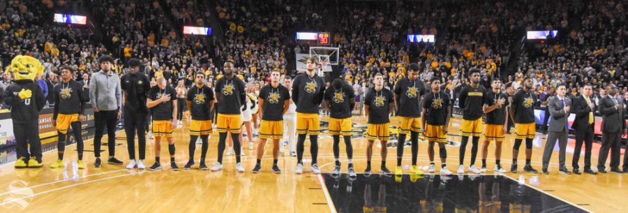 Wichita+State+players+and+coaches+stand+together+during+the+national+anthem+before+the+game+against+Abilene+Christian+on+Sunday+inside+Charles+Koch+Arena.
