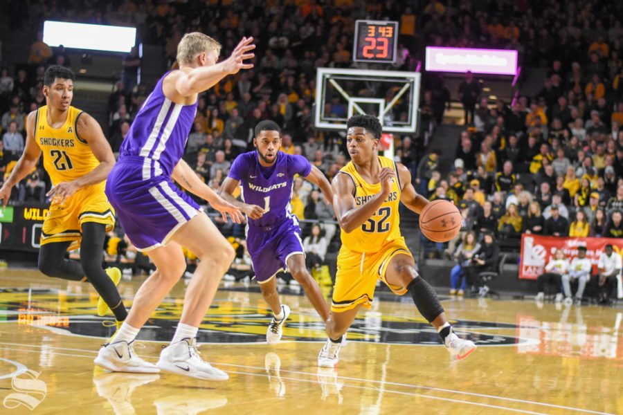 Wichita State freshman Grant Sherfield dribbles around Abilene Christian defenders during the game on Sunday. The Shockers defeated the Wildcats 84-66.