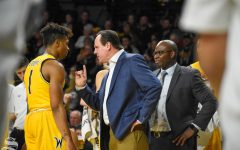 Head Coach Gregg Marshall talks to freshman Tyson Etienne during a timeout of the game against Abilene Christian on Sunday.