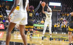 Brewer's late 3 lifts WSU women over Tulane