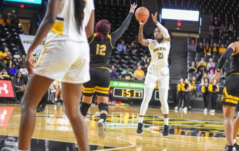 Senior Maya Brewer goes up for a basket on the three-point line during the game against the Grambling State Tigers on Monday, Dec. 30.