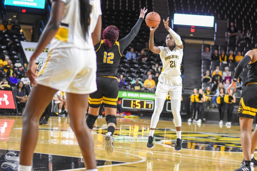 Senior+Maya+Brewer+goes+up+for+a+basket+on+the+three-point+line+during+the+game+against+the+Grambling+State+Tigers+on+Monday%2C+Dec.+30.