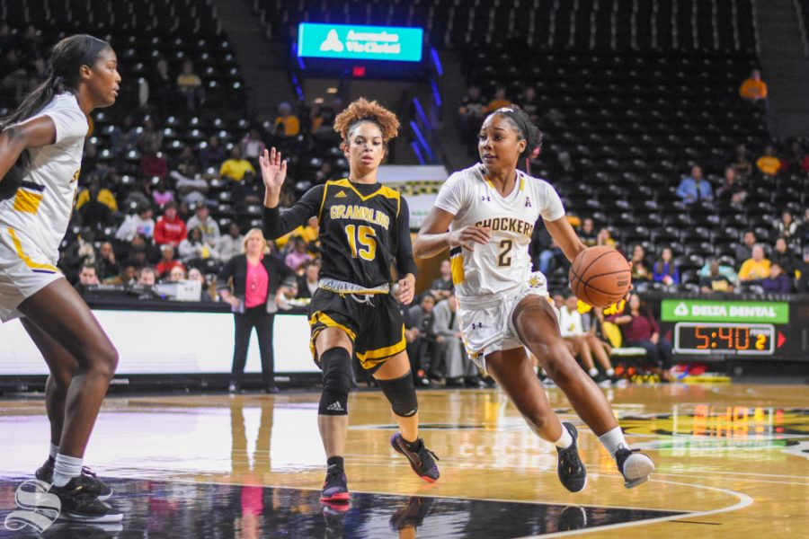 Junior Mariah McCully dribbles around Grambling State defender Candace Parramore during the game against the Tigers on Monday, Dec. 30.