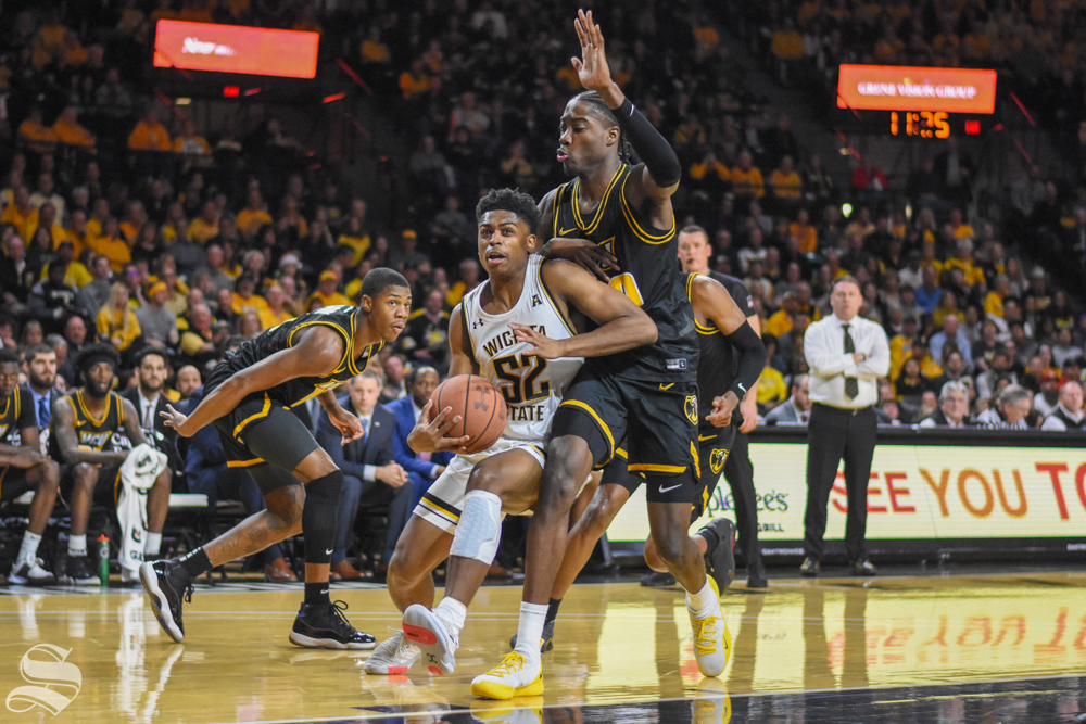 Freshman Grant Sherfield attacks the basket while VCU defends during the game on Saturday, Dec. 21 inside Charles Koch Arena.