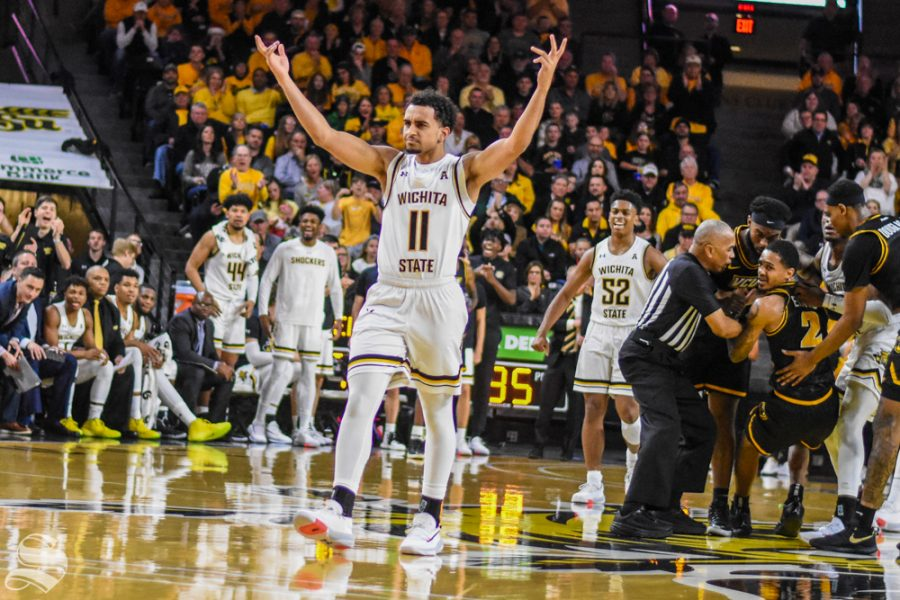 Freshman Noah Fernandes calls for the fans to cheer louder during the game against VCU on Saturday, Dec. 21 inside Charles Koch Arena.