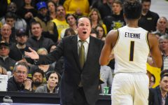 Head Coach Gregg Marshall speaks to freshman Tyson Etienne during the second half of the game against VCU on Saturday.