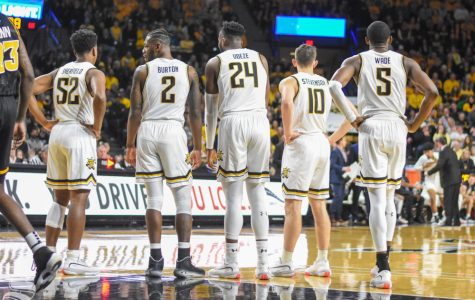 Wichita State players stand togther and look to Head Coach Gregg Marshall after a foul was called during the first half of the game against VCU on Saturday inside Charles Koch Arena. Sherfield, Burton and Stevenson have all transferred away from the program.