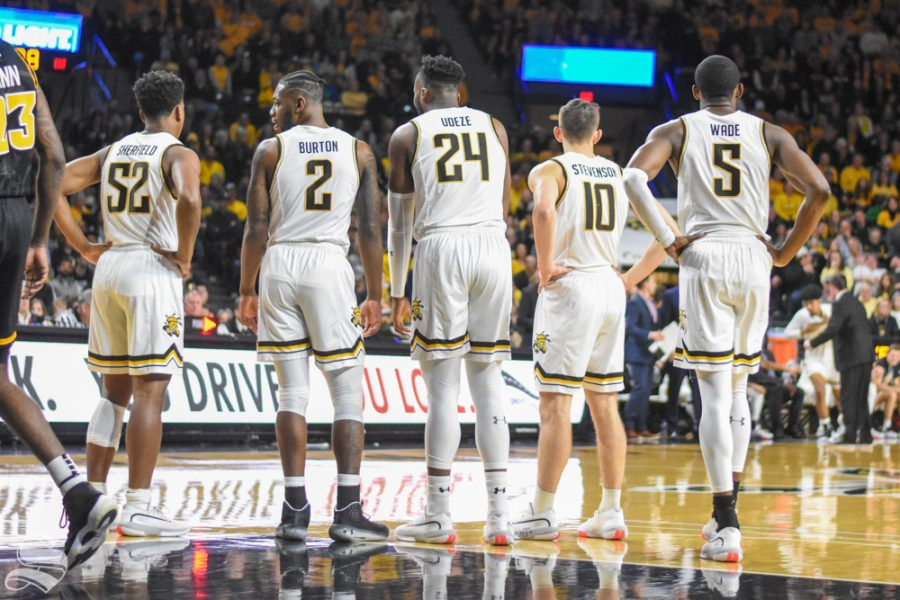 Wichita+State+players+stand+togther+and+look+to+Head+Coach+Gregg+Marshall+after+a+foul+was+called+during+the+first+half+of+the+game+against+VCU+on+Saturday+inside+Charles+Koch+Arena.+Sherfield%2C+Burton%2C+Udeze%2C+and+Stevenson+have+all+transferred+away+from+the+program.+